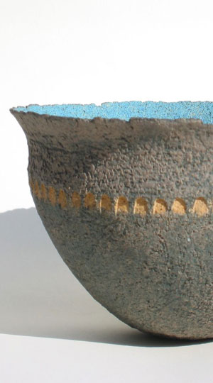 Ochre-impressed blue yellow bowl